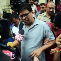 Indian activist Arun Ferreira speaks to the media as he is arrested in Mumbai's neighboring Thane district on Tuesday. | AFP-JIJI
