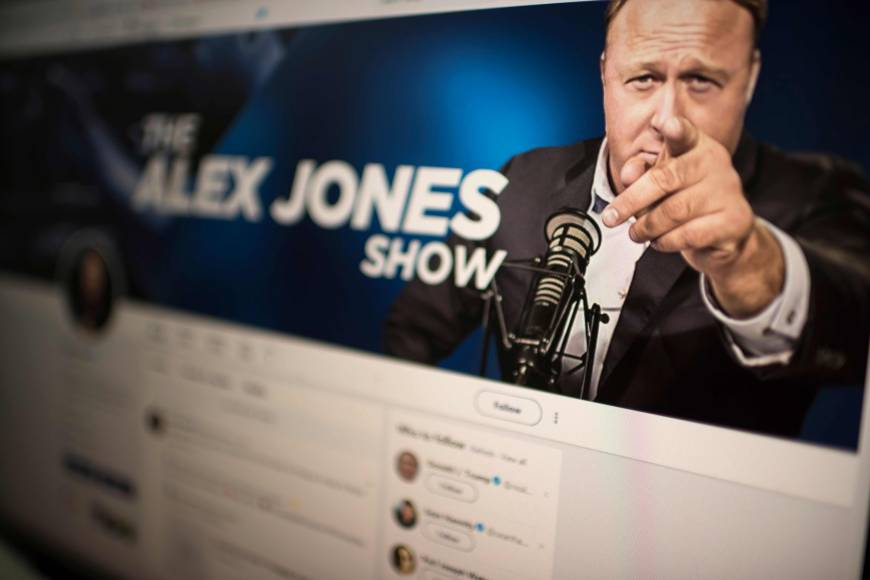 Far-right flame-thrower Alex Jones gets Twitter 'timeout' after urging supporters to take up 'battle rifles'