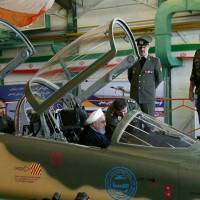 Iranian President Hassan Rouhani sits in the cockpit of a newly unveiled fighter jet in Tehran on Aug. 21. | REUTERS