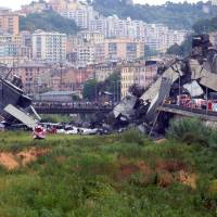 A section of a giant motorway bridge that collapsed is seen Tuesday in Genoa, Italy. | AFP-JIJI