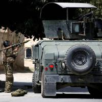 Islamic State takes credit as gunmen attack intelligence center in Kabul
