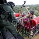 People are airlifted by the Indian Navy during a rescue operation at a flooded area in the southern state of Kerala on Friday.