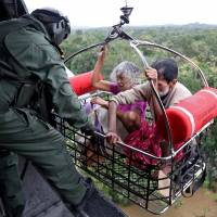 Death toll jumps to 164 in flooding in India's Kerala state