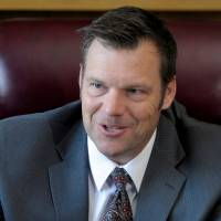 Kansas Secretary of State Kris Kobach talks in his office in Topeka in May 2016 about the voter ID law that he pushed to combat what he believes to be rampant voter fraud. | REUTERS