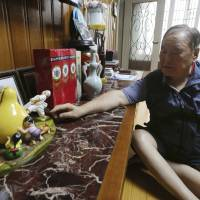 Ham Sung-chan, 93, shows gifts he received from his North Koran brother, Ham Dong Chan, during an interview at his house in Dongducheon, South Korea, Thursday. | AHN YOUNG-JOON / VIA AP