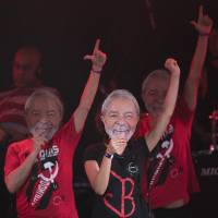 Artists wearing masks of former Brazilian President Luiz Inacio Lula da Silva perform at the Lula Free festival in Rio de Janeiro on July 28. | AP