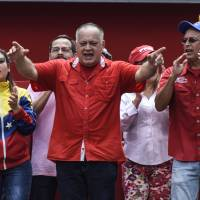 Diosdado Cabello, president of the National Constituent Assembly, speaks during a pro-government rally in support of Venezuelan President Nicolas Maduro, outside the Miraflores Palace in Caracas on Monday. Venezuela's ruling socialist party convened a rally on Monday to denounce the Saturday attempted drone attack on the president. | BLOOMBERG