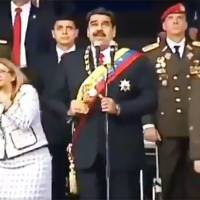 This video image shows Venezuelan President Nicolas Maduro, his wife, Cilia Flores, reacting to a loud bang during a ceremony to celebrate the 81st anniversary of the National Guard in Caracas on Saturday.   AFP-JIJI