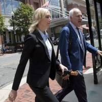 Paul Manafort's former bookkeeper, Heather Washkuhn, walks to the Alexandria Federal Courthouse in Alexandria, Virginia, Thursday to testify at the trial of President Donald Trump's former campaign chairman's tax evasion and bank fraud trial. Washkuhn testified that Paul Manafort kept her in the dark about the foreign bank accounts he was using to buy millions in luxury items and personal expenses. | AP