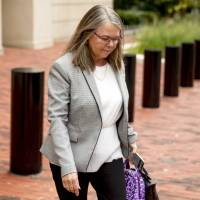 Accountant Cindy Laporta leaves the Alexandria Federal Courthouse in Virginia on Friday, the fourth day of the trial of former Trump campaign chairman Paul Manafort over alleged tax evasion and bank fraud. | AP
