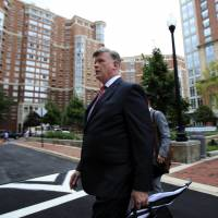 Kevin Downing, attorney for Paul Manafort, walks to the Alexandria Federal Courthouse in Alexandria, Virginia, Thursday for President Donald Trump's former campaign chairman's tax evasion and bank fraud trial. | AP