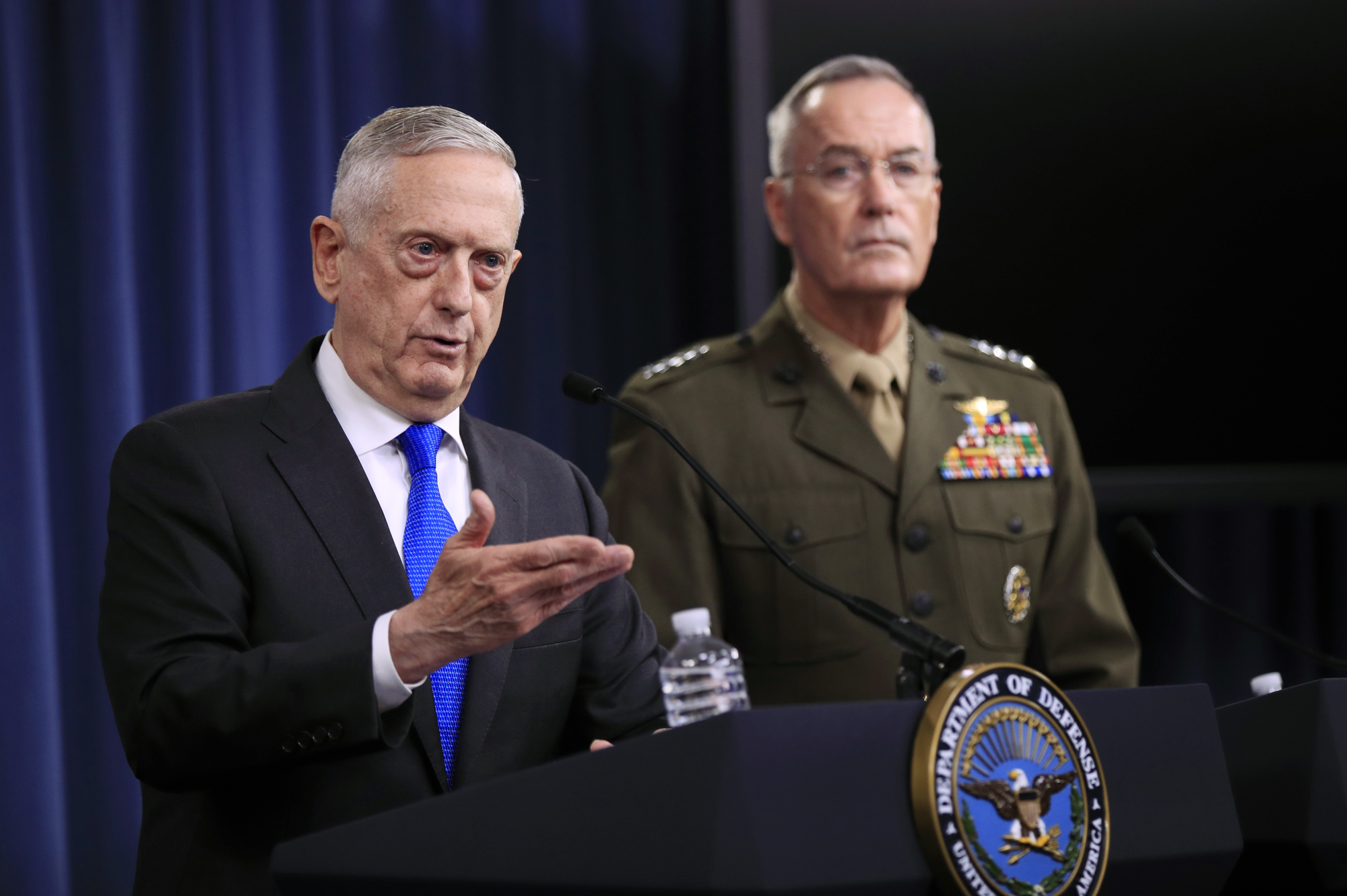 Secretary of Defense Jim Mattis (left) and Chairman of the Joint Chiefs of Staff Marine Gen. Joseph Dunford speak to reporters during a news conference at the Pentagon Tuesday in Washington. | MANUEL BALCE CENETA / VIA AP