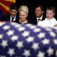 Sen. John McCain's family cries over his flag-draped casket as Arizona turns out to mourn