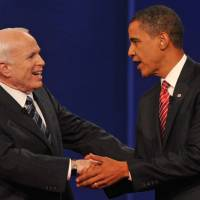 Then-Democratic presidential candidate Barack Obama and Republican rival John McCain greet each other at Hofstra University at the end of their third and final presidential debate in Hempstead, New York, on October 2008. McCain died Saturday after losing a battle to brain cancer. He was 81. | AFP-JIJI