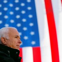 Then-U.S. Republican presidential nominee Sen. John McCain speaks at a campaign rally in Defiance, Ohio, in October 2008. | REUTERS