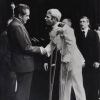 U.S. Navy Lt. Cmdr. John McCain is greeted by President Richard Nixon in Washington in May 1973 following McCain's release from a prisoner of war camp in North Vietnam. McCain died Saturday at the age of 81. | AP