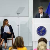 U.S. first lady Melania Trump and U.S. Health and Human Services Secretary Alex Azar listen to Joseph Grunwald speak at the Federal Partners in Bullying Prevention (FPBP) Cyberbullying Prevention Summit on the positive and negative effects of social media on youth in Rockville, Maryland, Monday. | CHRIS WATTIE / VIA REUTERS