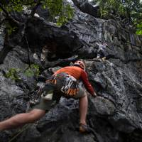 This photo taken on June 9 shows members of Climb Yangon during their rock climbing training at Bayin Nyi cave at Hpa-an, Karen state. A two-week jungle trek followed by a sheer climb up avalanche-prone slopes to a jagged ridge of icy pinnacles awaits three Myanmar mountaineers planning to take on Hkakabo Razi, a peak so treacherous it has only been conquered once. | YE AUNG THU / VIA AFP-JIJI
