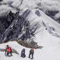 This handout photo released by Hkakabo Razi Expedition 2018 on Monday and taken last November shows Myanmar mountaineers during their ascent of Ama Dablam mountain in Nepal, in preparation for a mountaineering expedition to Hkakabo Razi on the northern tip of Myanmar near the border with China and India. | HKAKABO RAZI EXPEDITION 2018 / HANDOUT / VIA AFP-JIJI
