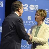 New York Gov. Andrew M. Cuomo and Cynthia Nixon shake hands at Hofstra University in Hempstead on Wednesday ahead of their the Democratic gubernatorial primary debate. The winner of the Democratic primary faces Republican Marc Molinaro and independent Stephanie Miner in November. | J. CONRAD WILLIAMS JR. / NEWSDAY / VIA AP