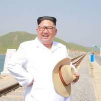 North Korean leader Kim Jong Un inspects the completed railway that connects Koam and Tapchon on the eastern coast in May. | REUTERS