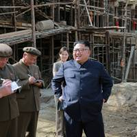 In this undated photo released Sunday, North Korean leader Kim Jong Un is seen giving on-the-spot guidance during a visit to a construction site in Samjiyon county. | REUTERS