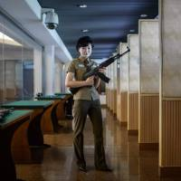Travelers to Pyongyang can try North Korean and foreign firearms at the Meari shooting range under the guidance of instructors like Kim Ju Yang. Most are modified to fire .22-caliber ammunition, and bring the regime $1 per round. | AFP-JIJI