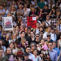 An estimated 4000 protesters rally at Sydney Town Hall on Feb. 8, 2016, to demonstrate their opposition to Australia's deportation and detention of asylum seeker children to offshore processing centers on Manus Island and Nauru. | PACIFIC PRESS/SIPA USA