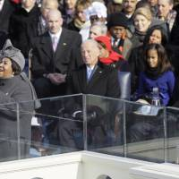 Aretha Franklin performs during the inauguration ceremony as Joe Biden (left), Barack Obama (right) and his daughter, Malia Obama, watch at the U.S. Capitol in Washington in 2009. | AP