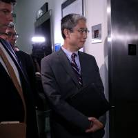 Former associate deputy U.S. attorney general Bruce Ohr enters an elevator after testifying behind closed doors before the House Judiciary and House Oversight and Government Reform Committees on his alleged contacts with Fusion GPS founder Glenn Simpson and former British spy Christopher Steele, who compiled a 'dossier' of allegations linking Donald Trump to Russia, on Capitol Hill in Washington Tuesday. | CHRIS WATTIE / VIA REUTERS