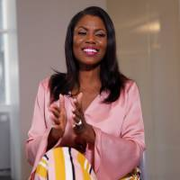 Former U.S. White House staffer Omarosa Manigault-Newman claps during an interview on the release of her book 'Unhinged' in Manhattan, New York, Tuesday. | REUTERS