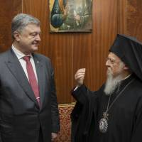 Ecumenical Orthodox Patriarch Bartholomew I speaks with Ukrainian President Petro Poroshenko in Istanbul in April. Poroshenko visited in an effort to convince the patriarch to agree to a split, which he has described as 'a matter of our independence and our national security.' Moscow's Patriarch Kirill is planning to fly to Turkey in late August in a last-ditch bid to prevent it.   MIKHAIL PALINCHAK / PRESIDENTIAL PRESS SERVICE POOL PHOTO / VIA AP