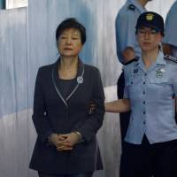 Ousted South Korean President Park Geun-hye arrives at a court in Seoul in August 2017. | REUTERS