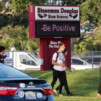 Students arrive for the the first day of classes at Marjory Stoneman Douglas High School in Parkland, Florida, Wednesday. | REUTERS