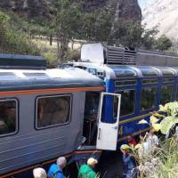 In this photo provided by the government news agency Andina, passeners observe two trains after they collided in Cuzco, Peru, Tuesday. The two trains collided near the ancient Incan citadel of Machu Picchu, a prized archaeological site in Peru visited by thousands of tourists each year. | ANDINA NEWS AGENCY / VIA AP