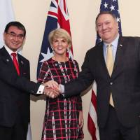 U.S. Secretary of State Mike Pompeo (right) shows solidarity with Japanese Foreign Minister Taro Kono and Australian Foreign Minister Julie Bishop before a trilateral meeting on the sidelines of the 51st Association of Southeast Asian Nations (ASEAN) Ministerial Meeting (AMM) in Singapore on Saturday. | AFP-JIJI