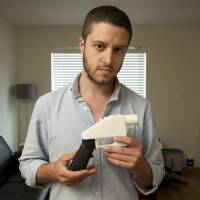 Cody Wilson, the founder of the company Defense Distributed, displays a plastic handgun he made on a 3D printer at his home in Austin, Texas, in 2013. | AP