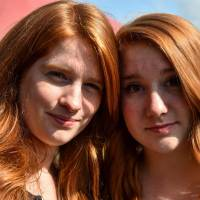Two women pose during the 'Red Love Festival,' the first festival dedicated to redheads, on Saturday in Chateaugiron, near Rennes, western France. | AFP-JIJI