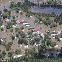 Torrential rains Monday night and Tuesday sent the Kickapoo River over its banks in Wisconsin, flooding Gays Mills, which was bracing for an even higher crest on Wednesday. | ERIK DAILY/LA CROSSE TRIBUNE / VIA AP