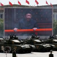 Chinese President Xi Jinping is displayed on a screen in Beijing in September 2015 during a parade commemorating the 70th anniversary of Japan's surrender in World War II. | AP