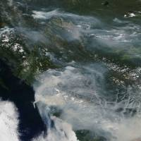 Smoke from wildfires across U.S. West and Canada blots out mountains, poses health risks