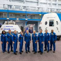 The first U.S. astronauts who will fly on American-made commercial spacecraft to the International Space Station, from left: Sunita Williams, Josh Cassada, Eric Boe, Nicole Mann, Christopher Ferguson, Douglas Hurley, Robert Behnken, Michael Hopkins and Victor Glover. | AFP-JIJI