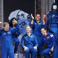 Future astronauts on the Boeing Starliner and SpaceX Crew Dragon react after being introduced by NASA in Houston on Friday. From left: Eric Boe, Sunita Williams, Christopher Ferguson, Josh Cassada and Nicole Aunapu Mann. | AP