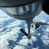 One of two U.S. Air Force F-22 stealth fighter jets receives fuel midair from a KC-135 refueling plane over Norway en route to a joint training exercise with Norway's growing fleet of F-35 jets Wednesday. | REUTERS
