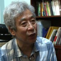 China arrests critic Sun Wenguang during live TV interview