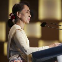 Myanmar's leader Aung San Suu Kyi speaks at at the 43rd Singapore Lecture organized by the Institute of South East Asian Studies on Tuesday. | AP