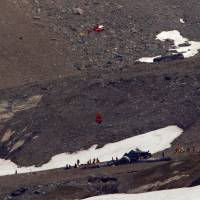Swiss police say all 20 aboard vintage plane that crashed near-vertically on mountain died