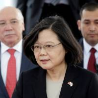 Taiwan's President Tsai Ing-wen walks alongside Paraguay's Foreign Minister Eladio Loizaga in Luque, Paraguay, on Aug. | REUTERS