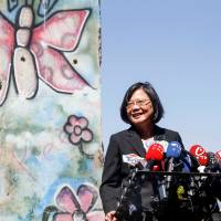 Taiwanese President Tsai Ing-wen, standing by a section of the Berlin Wall, speaks to media at the Ronald Reagan Presidential Library in Simi Valley, California, on Monday. | REUTERS
