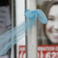 A ribbon for missing University of Iowa student Mollie Tibbetts hangs on a light post in Brooklyn, Iowa, Aug. 21. | AP